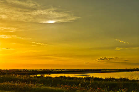 deep sunset on brackish wetlands 스톡 콘텐츠 - 104452224