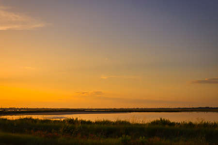 deep sunset on brackish wetlands 스톡 콘텐츠 - 104033723