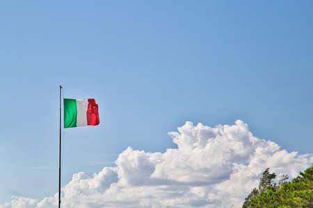 italian flag waving on cloudy sky background