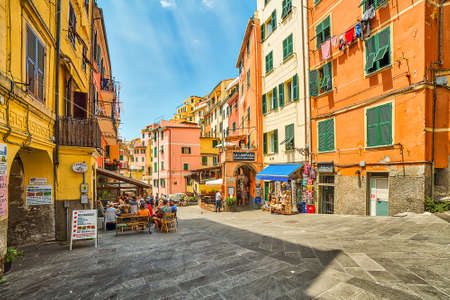 RIOMAGGIORE (SP), ITALY - JUNE 16, 2018: tourists walk and go shopping in the street Editorial