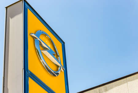FAENZA (RA), ITALY - JUNE 23, 2018: Dirt and dust cover the OPEL logo on dealer signboard
