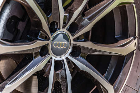 RAVENNA, ITALY - JUNE 30, 2018: Dirt and dust cover the AUDI logo on an alloy wheel Redactioneel