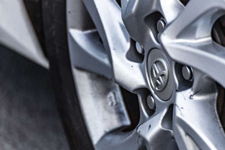 RAVENNA, ITALY - JUNE 30, 2018: Dirt and dust cover the TOYOTA logo on an alloy wheel