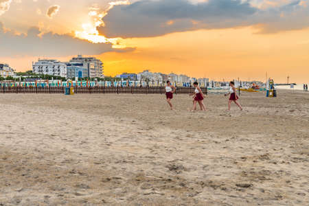 RICCIONE (RN), ITALY - JULY 5, 2018:  Young gymnasts are preparing on the beach to perform at the Festival del Sole Editorial