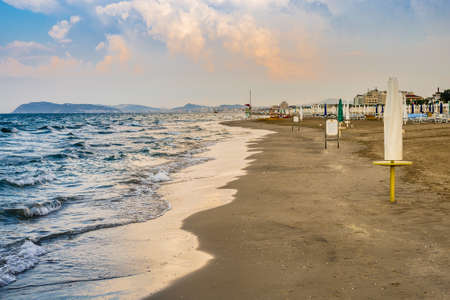 RICCIONE (RN), ITALY - JULY 5, 2108: summer season in entering into the peak period and deck chairs and sunshades of seaside resorts are waiting for welcoming tourists