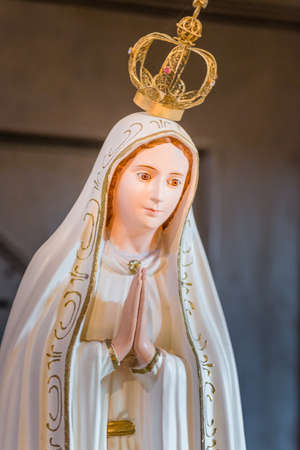 RAVENNA, ITALY - august 2, 2018: Statue of Our Lady of Fatima praying in  Church of Saint Mary of Suffrage in Ravenna Sajtókép