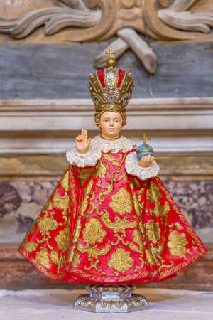RAVENNA, ITALY - AUGUST 2, 2018: Infant Jesus of Prague holding cruciger inside  Church of Saint Mary of Suffrage in Ravenna 에디토리얼
