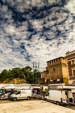 LUGO (RA), ITALY - JUNE 5, 2013: people are going for shopping in stalls of weekly market