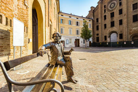 PARMA, ITALY – AUGUST 23, 2018: statue of Giuseppe Verdi sitting on a bench in Parma, elegant town in the Emilia-Romagna region of Northern Italy