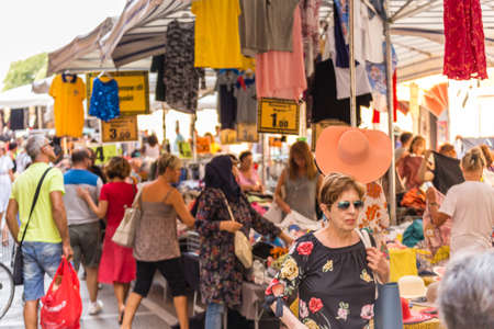FERRARA, ITALY - AUGUST 24, 2018: Tourists and locals have fun shopping in the weekly market Redactioneel