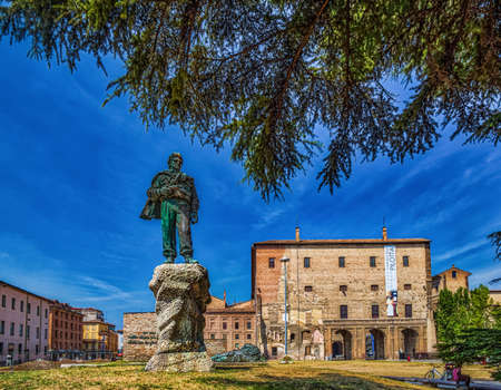 PARMA, ITALY – AUGUST 23, 2018: partisan standing in Monument to Italian Resistance in front of Pilotta Editorial