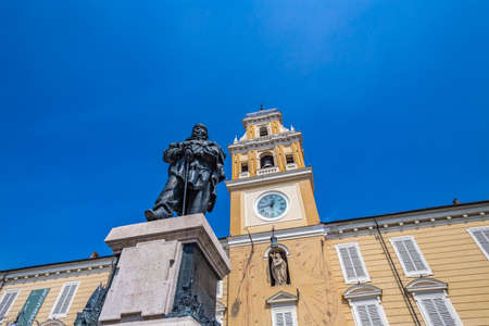 PARMA, ITALY – AUGUST 23, 2018:  statue of Garibaldi in front of sundials telling time using the position of the sun on palace of governor in Parma, historic town in Emilia-Romagna in Northern Italy
