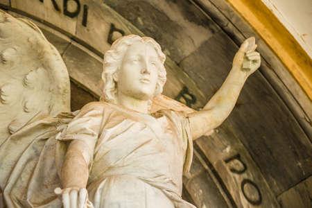 closeup of statue of angel raising hand upwards