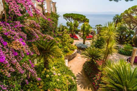 RAVELLO (SA), ITALY - AUGUST 29, 2018: tourists visiting the lush gardens of Villa Rufolo Editorial