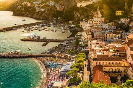 AMALFI (SA), ITALY - AUGUST 28, 2018: tourists walking  on the pier of Amalfi