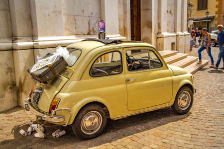 SORRENTO (NA), ITALY - SEPTEMBER 3, 2018: FIAT 500 is waiting for the arrival of bride and groom