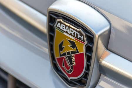 LUGO, ITALY - September 11, 2018: light enlightening FIAT ABARTH logo on a car body
