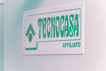 LUGO (RA), ITALY – SEPTEMBER 11, 2018: Dust and dirt covering the TECNOCASA logo on signboard Editorial