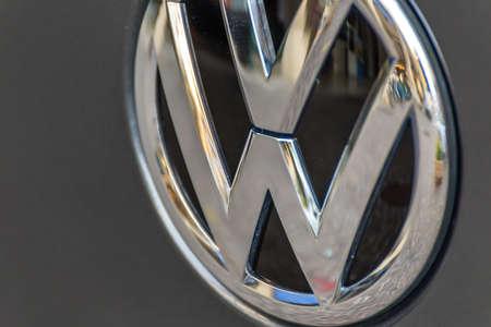 LUGO, ITALY - September 11, 2018: light enlightening Volkswagen logo on a car body