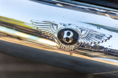 LUGO, ITALY - September 11, 2018: light enlightening BENTLEY logo on a car body