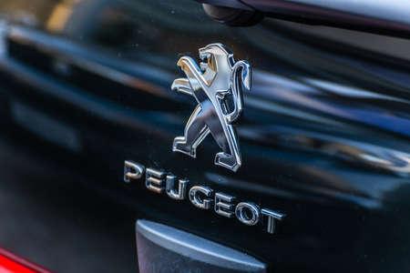 LUGO, ITALY - September 11, 2018: light enlightening Peugeot logo on a car body Editorial