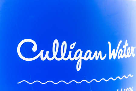 LUGO (RA), ITALY – SEPTEMBER 11, 2018: Dust and dirt covering the CULLIGAN logo on signboard