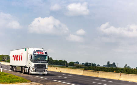FAENZA (RA), SEPTEMBER 15, 2018: The truck with the TOMEI  logo moves quickly on the highway Editorial