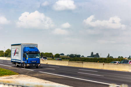 FAENZA (RA), SEPTEMBER 15, 2018: The truck with the CONSAR GROUP logo moves quickly on the highway Editorial