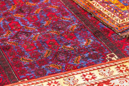 CESENA (FC), ITALY - SEPTEMBER 16, 2018: lights enlightening Persian carpet at antiques fair in Cesena Standard-Bild - 108349463