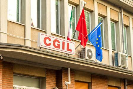 CERVIA (RA), ITALY - SEPTEMBER 16, 2018: light enlightening CGIL logo on building
