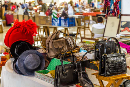 CESENA (FC), ITALY - SEPTEMBER 16, 2018: lights enlightening bags and hats at antiques fair in Cesena
