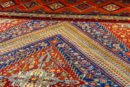CESENA (FC), ITALY - SEPTEMBER 16, 2018: lights enlightening Persian carpet at antiques fair in Cesena Standard-Bild - 108349587