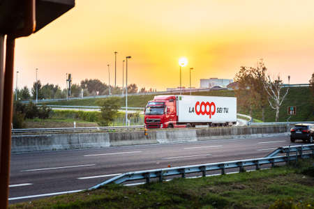 FAENZA (RA), ITALY - SEPTEMBER 20, 2018: truck with COOP logo running on highway