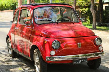 ISCHIA (NA), ITALY - SEPTEMBER 18, 2012: sun is enlightening red FIAT 500 on Ischia island