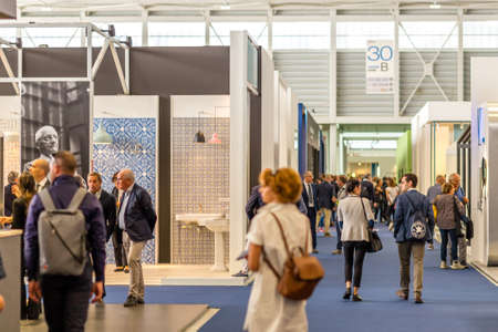 BOLOGNA (ITALY), SEPTEMBER 26, 2018: Visitors are walking in the aisles and visiting the stands of the exhibitors at CERSAIE, international exhibition of ceramic tile and bathroom furnishings Sajtókép