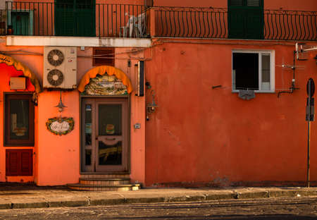 ISCHIA  (NA), ITALY - SEPTEMBER 20, 2012: sun is enlightening ancient buildings on Ischia island