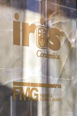 BOLOGNA (ITALY), SEPTEMBER 26, 2018: light is enlightening IRIS CERAMICA logo at CERSAIE, international exhibition of ceramic tile and bathroom furnishings Editorial