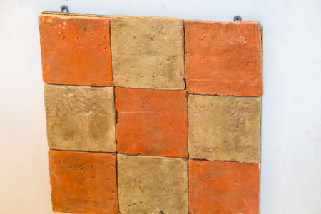 Checkerboard of yellow and orange Tiles
