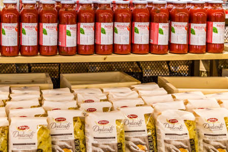 BOLOGNA, ITALY - OCTOBER 2, 2018: lights are enlightening pasta, tomato sauce and puree at FICO EATALY WORLD, the largest agri-food park in the world Editorial
