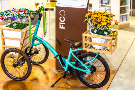 BOLOGNA, ITALY - OCTOBER 2, 2018: lights are enlightening vintage BIANCHI bicycles with shopping basket at FICO EATALY WORLD, the largest agri-food park in the world