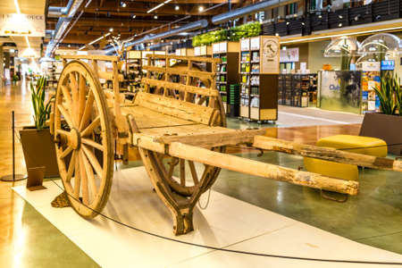 BOLOGNA, ITALY - OCTOBER 2, 2018: lights are enlightening Old wooden wagon at FICO EATALY WORLD, the largest agri-food park in the world Editorial