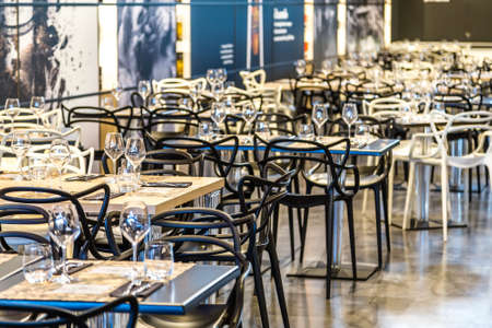 BOLOGNA, ITALY - OCTOBER 2, 2018: lights are enlightening tables and chairs of restaurant at FICO EATALY WORLD, the largest agri-food park in the world