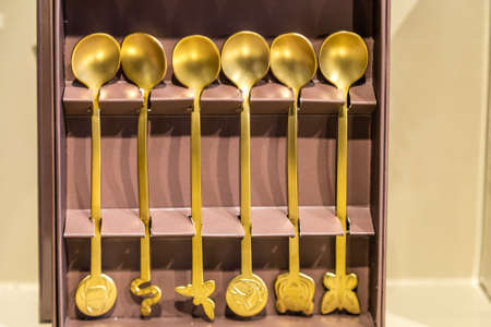 BOLOGNA, ITALY - OCTOBER 2, 2018: lights are enlightening golden teaspoons at FICO EATALY WORLD, the largest agri-food park in the world