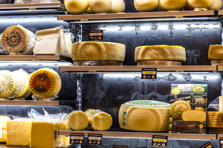 BOLOGNA, ITALY - OCTOBER 2, 2018: lights are enlightening wheels of cheese fo sale at FICO EATALY WORLD, the largest agri-food park in the world Editorial