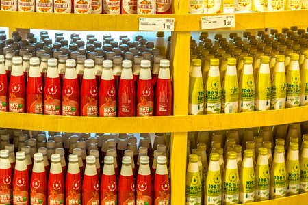 BOLOGNA, ITALY - OCTOBER 2, 2018: lights are enlightening organic fruit and vegetables juice bottles at FICO EATALY WORLD, the largest agri-food park in the world