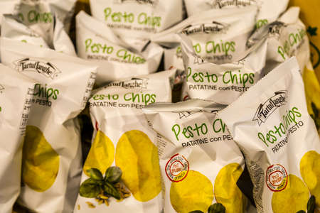 BOLOGNA, ITALY - OCTOBER 2, 2018: lights are enlightening TartufLanghe pesto chips at FICO EATALY WORLD, the largest agri-food park in the world