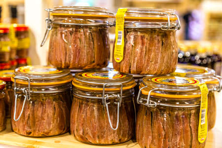 BOLOGNA, ITALY - OCTOBER 2, 2018: lights are enlightening Anchovies for sale at FICO EATALY WORLD, the largest agri-food park in the world