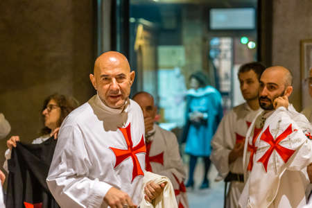 FORLI, ITALY - OCTOBER 26, 2018: Catholic Templar Knights participate in the ritual of Holy Mass. On the left Magister Mauro Giorgio Ferretti