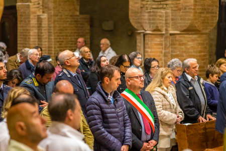FORLI, ITALY - OCTOBER 26, 2018: The city mayor Davide Drei and Catholic Templar Knights participate in the ritual of Holy Mass with exposition of relics of Saint Mercuriale. On left Magister Ferretti Editorial
