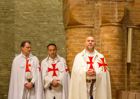 FORLI, ITALY - OCTOBER 26, 2018: Catholic Templar Knights participate in the ritual of Holy Mass. On the right Magister Mauro Giorgio Ferretti